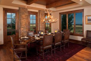 Rustic Dining Room with Hardwood floors, Chandelier, French doors, Exposed beam
