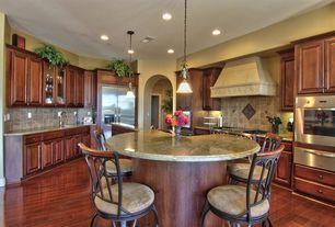 Mediterranean Kitchen with Stone Tile, Undermount sink, Kitchen island, Limestone Tile, Raised panel, Custom hood, U-shaped