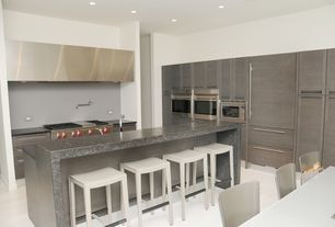 Modern Kitchen with Kitchen island, Flat panel cabinets, Soapstone counters, Flush, L-shaped, Breakfast bar