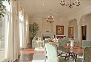 Traditional Living Room with High ceiling, Chandelier, Cement fireplace, Transom window, Hardwood floors, French doors