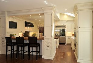 Traditional Kitchen with Crown molding, Wood counters, Antique birch hardwood flooring, Wood paneling