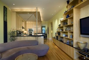 Modern Great Room with Built-in bookshelf, Hardwood floors