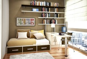 Contemporary Guest Bedroom with Built-in bookshelf, Laminate floors, can lights, picture window, Standard height