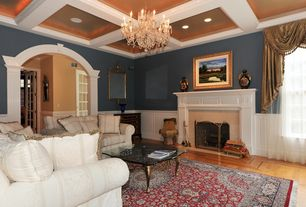 Contemporary Living Room with Chandelier, Wainscotting, Hardwood floors, Box ceiling, Chair rail, Cement fireplace