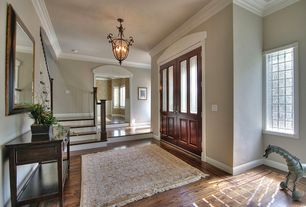 Traditional Entryway with Glass panel door, Crown molding, Hardwood floors, flush light