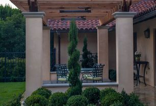 Mediterranean Patio with exterior tile floors, Outdoor seating area, Pergola, Exterior stucco walls, Fence, Trellis