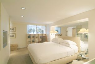 Contemporary Master Bedroom with specialty window, Wall sconce, Carpet, Built-in bookshelf, can lights, Standard height