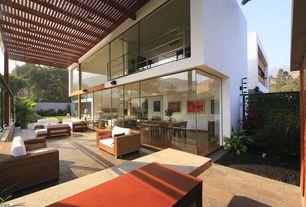 Contemporary Porch with Fence, Wrap around porch, exterior tile floors
