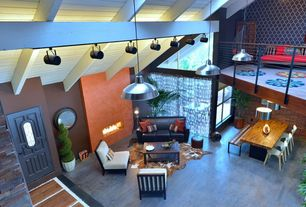 Eclectic Great Room with Concrete floors, Exposed beam, flush light, interior brick, insert fireplace, Fireplace, Loft