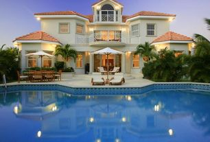 Mediterranean Swimming Pool with sliding glass door, Deck Railing, Fence, double-hung window, exterior tile floors