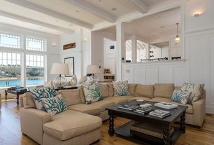 Traditional Living Room with Hardwood floors, Blue Coral Euro Pillows, Crown molding, Pottery Barn Classic Ribbed Pendant