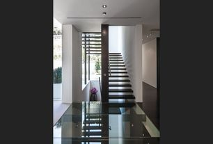 Modern Staircase with Floating staircase, Columns, Hardwood floors, High ceiling