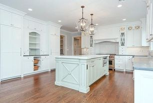 Traditional Kitchen with U-shaped, Pendant light, Limestone, Corian counters, Custom hood, Crown molding, Flush, Glass panel