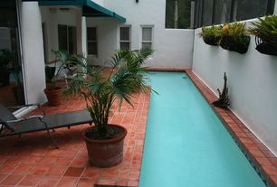 Traditional Swimming Pool with exterior awning, exterior tile floors, Raised beds, exterior terracotta tile floors, Fence