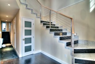 Contemporary Staircase with sandstone floors, Chair rail, CableRail 40 ft. Stainless Steel Assembly Kit, Wall sconce
