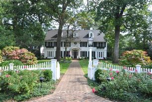 Traditional Exterior of Home with Brick pathway, Gate, White picket fence