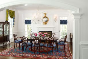 Traditional Dining Room with Wainscotting, Chandelier, double-hung window, Standard height, Fireplace, Wall sconce