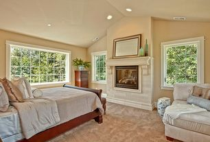 Traditional Master Bedroom with Fireplace, can lights, Standard height, stone fireplace, Carpet, Casement