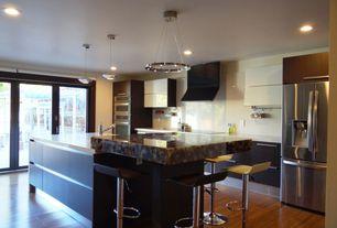 """Traditional Kitchen with Kitchen island, Elan crushed ice led 24"""" wide round chrome pendant light, Flush, Hardwood floors"""