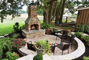 Rustic Patio with exterior stone floors, Raised beds, Fence, outdoor pizza oven