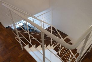 Modern Staircase with Cathedral ceiling, curved staircase, Hardwood floors
