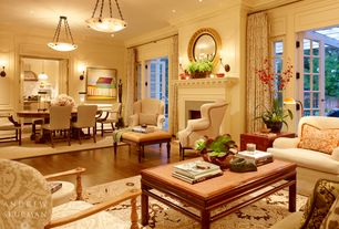 Traditional Living Room with French doors, SOMERSET FRAMED ROUND MIRROR, Cement fireplace, Fireplace, Chair rail, Wall sconce