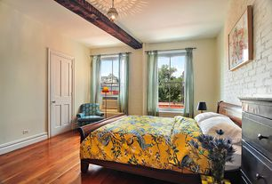 Craftsman Master Bedroom with Hardwood floors, specialty door, Painted brick wall, Hardwood flooring, interior brick