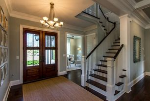 Craftsman Entryway with Crown molding, Hardwood floors, French doors, Chandelier