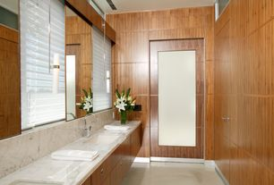 Contemporary Master Bathroom with Double sink, European Cabinets, Concrete tile , Complex marble counters, Wall sconce, Flush