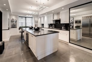 Modern Kitchen with built-in microwave, Built In Refrigerator, Pendant light, Breakfast bar, electric cooktop, Kitchen island