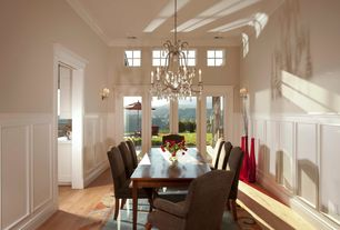 Traditional Dining Room with Chandelier, can lights, High ceiling, Crown molding, picture window, Wainscotting, French doors