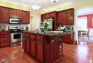Craftsman Kitchen with Flat panel cabinets, Kitchen island, Inset cabinets, European Cabinets, L-shaped, Stone Tile