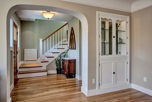 Craftsman Entryway with Hardwood floors, flush light, Coved ceiling, Glass panel door, Built-in bookshelf, picture window
