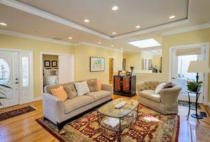 Traditional Living Room with French doors, Glass panel door, Crown molding, Hardwood floors