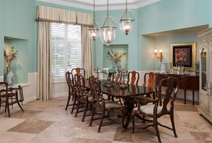 Traditional Dining Room with Crown molding, Wall sconce, Wainscotting, travertine floors, Pendant light, Built-in bookshelf