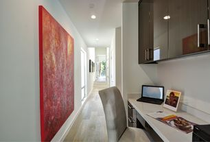 Contemporary Home Office with can lights, Hardwood floors, double-hung window, Built-in bookshelf, Standard height