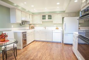 Traditional Kitchen with U-shaped, partial backsplash, Inset cabinets, electric cooktop, can lights, dishwasher, Raised panel