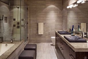 Contemporary Master Bathroom with Master bathroom, Vessel sink, Rain shower, stone tile floors, Wall Tiles, Flush, Bathtub