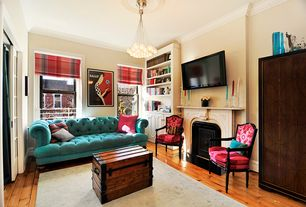 Eclectic Living Room with Crown molding, Ethan allen claudette chair, Statement Piece Vintage Salesman's Wooden Trunk