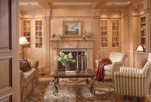 Traditional Living Room with Built-in bookshelf, Cement fireplace, Box ceiling, Crown molding, Hardwood floors