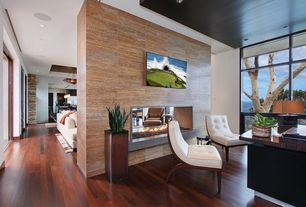 Contemporary Home Office with Fireplace, Hardwood floors, interior wallpaper, picture window, insert fireplace, can lights