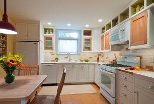 Eclectic Kitchen with Casement, Breakfast nook, Corian Glacier White, Built In Refrigerator, dishwasher, can lights, L-shaped
