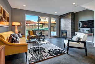 Modern Living Room with Concrete floors, stone fireplace, Built-in bookshelf