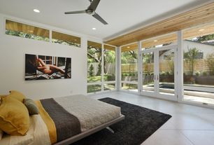 Contemporary Master Bedroom with Pottery Barn Belgian Flax Linen Floral Stitch Sham, Ceiling fan, sandstone tile floors