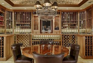Traditional Wine Cellar with Chandelier, limestone floors, Crown molding