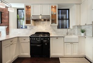 "Contemporary Kitchen with double-hung window, White 30"" farmhouse fireclay kitchen sink, Stone Tile, Black window casing"