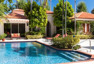 Tropical Swimming Pool with exterior concrete tile floors, Raised beds, Pathway, Lap pool, exterior tile floors