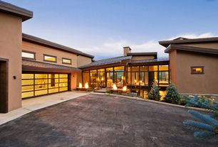 Contemporary Exterior of Home with picture window, specialty door, Standard height, Concrete floors