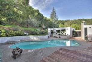 Modern Swimming Pool with French doors, Pathway, exterior tile floors, Raised beds, Fence