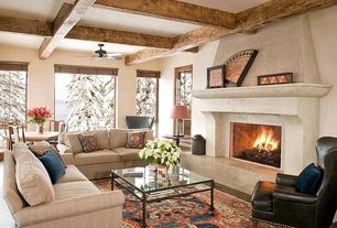 Eclectic Living Room with Pottery barn thatcher leather wingback chair, Ceiling fan, Ralph lauren home eastwood red area rug